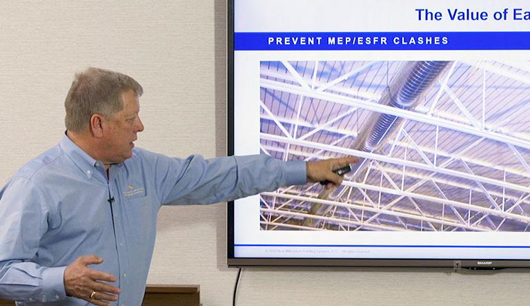 Joe Buntyn pointing to presentation Online credit hour courses