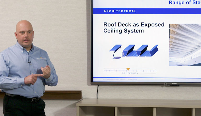 Sean Smith showing Roof Deck Exposed Ceiling System in ppt presentation Joe Buntyn pointing to presentation Online credit hour courses