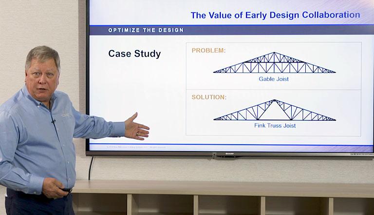 Joe Buntyn presenting ppt of a case study 3-piece Fink Truss Joe Buntyn pointing to presentation Online credit hour courses